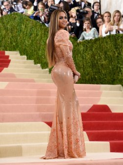 Beyoncé continues 2016 as heretofore, which is to slay all comers in her wake. She turned up on the Red Carpet minus Jay Z, which in wake of the whole album-outs-hubby-as-cheating-skank gate was never going to pass unnoticed. Her latex gown by Givenchy has puffed sleeves, which I have never seen in a latex gown before and which make the whole skintight-latex thing feel more haute and less rubber doll. Also noted: good hair.