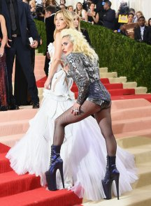 This photo of Lady Gaga feeling Kate Hudson's bottom is quite weird. Not least because Hudson is the one wearing a dress, and Gaga is only in tights, and yet Gaga has shifted the spotlight onto the other bottom. WHAT DOES IT MEAN. Hudson's dress is quite fun by the standards of Hudson, who is usually a pretty dull, just-make-me-look-hot dresser. Gaga looks a bit morning-after, like someone you'd see on a fire escape having a 5am cigarette break with the party still going on inside.