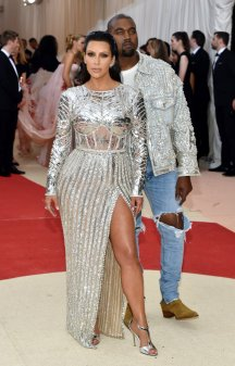 Gunmetal grey wasn't bling enough for the Kardashian-Wests, so they went for straight-up silver. Balmain, obvs. Kim's C3PO bodice is awesome, and the styling is on point: note the slicked back hair, and the spiky ear cuffs. Kanye's silver jacket and ripped jeans, on the other hand - really, Kanye? You think? Because you look like a country singer topping the bill at Vegas.