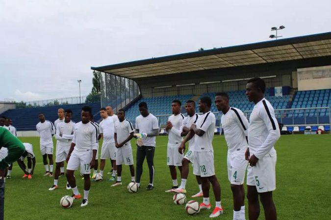 The Super Eagles receive some tactical advise during a training session
