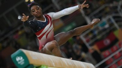 US gymnast Simone Biles competes in the beam event during the Artistic Gymnastics team final, at the Rio 2016 Olympic Games, on August 9