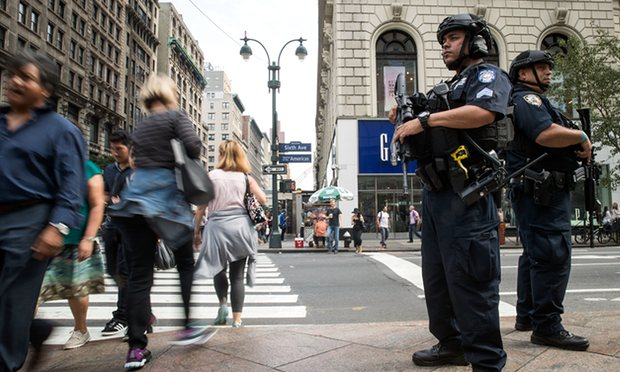 New York police officers guard Herald Square after Saturday night's explosion in the Chelsea neighbourhood of Manhattan