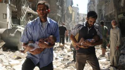 Syrian men carrying babies