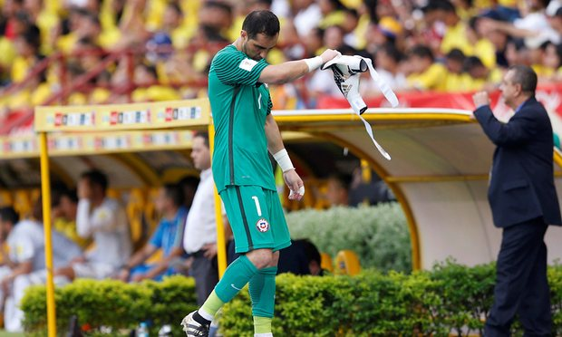 Claudio Bravo leaves the pitch after hurting his hip during Chile's goalless draw with Colombia in Barranquilla on Thursday. Photograph: John Vizcaino/Reuters