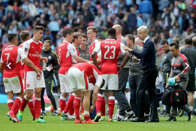 Arsene Wenger and Arsenal Players