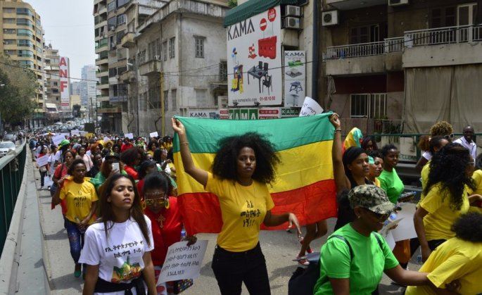 Ethiopian migrant workers hold up the Ethiopian flag at the annual Migrant Workers' March in Beirut.