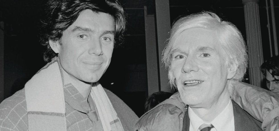 """Richard Bernstein, left, and Andy Warhol, circa 1980. Mr. Warhol, who commissioned Mr. Bernstein to create the covers for Interview magazine, said Mr. Bernstein """"makes everyone look so famous. Photo: Bobby Grossman/Rizzoli"""