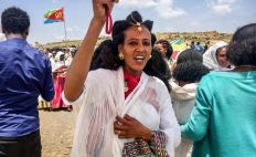 While on Tuesday, an Eritrean woman sings after crossing into Ethiopia. Parts of the border between the two nations reopened after a war between the two nations forced its closure more than 20 years ago.