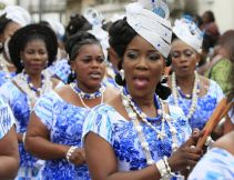 Also on Saturday, these women wear matching outfits at a festival in Ivory Coast to honour the Ebrie people, who hundreds of years ago fled the Ashante kingdom in what is now Ghana...