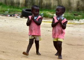 These siblings attend the Twins Day celebration in Ivory Coast's main city, Abidjan on Saturday...