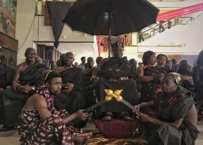While in Ghana's capital Accra on Wednesday, people pay their respects to former UN chief Kofi Annan as his body lies in state ahead of his burial the next day.