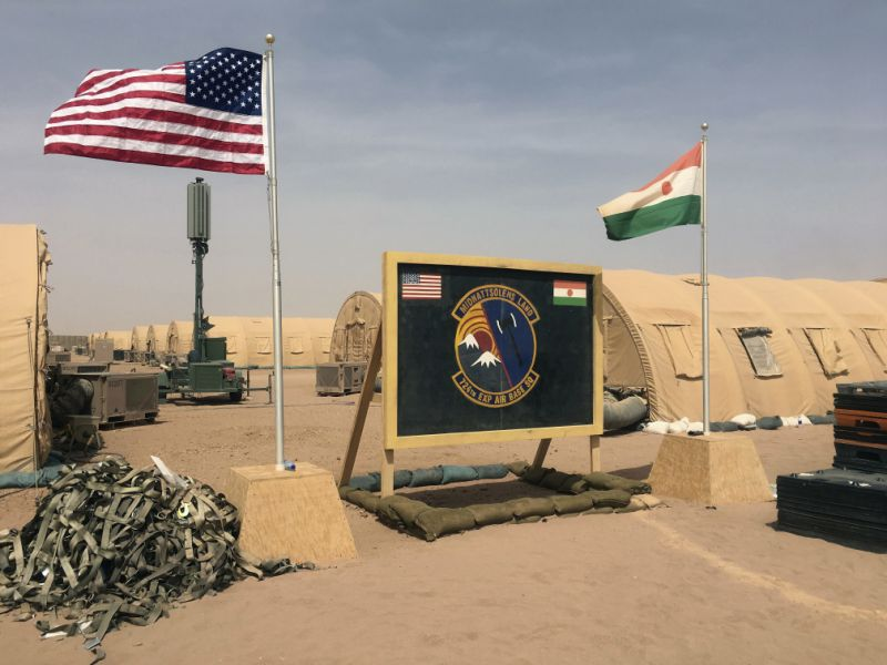 In this photo taken Monday, April 16, 2018, a U.S. and Niger flag are raised side by side at the base camp for air forces and other personnel supporting the construction of Niger Air Base 201 in Agadez, Niger. On the scorching edge of the Sahara Desert, the U.S. Air Force is building a base for armed drones, the newest front in America's battle against the growing extremist threat in Africa's vast Sahel region. Three hangars and the first layers of a runway command a sandy, barren field. Niger Air Base 201 is expected to be functional early next year. (AP Photo/Carley Petesch)
