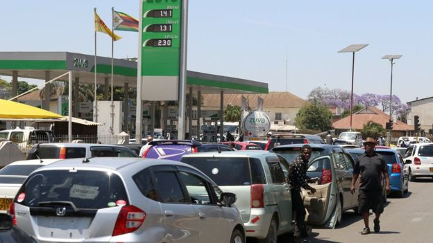 The crisis has led to a shortage of fuel with motorists having to queue for petrol. Photo: EPA