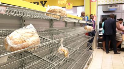 Many shops have run out of essential items like bread. Photo: EPA