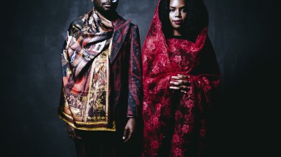 """James Jean, who is Haitian-American, and Patrice Worthy, who is African-American, wearing traditional clothing from their parents' heritage. New York, United States, 2016. From the series """"After Migration."""" Photo: Walé Oyéjidé"""