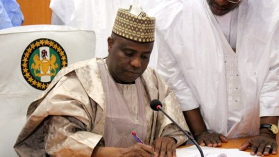 Sokoto State Governor, Aminu Tambuwal signing the 2018 budget into law. Photo: Premium Times