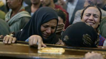 Relatives react during the funeral of one of the people killed after a bus carrying Coptic Christians was attacked in Egypt's southern Minya province. Photo: STR/EPA