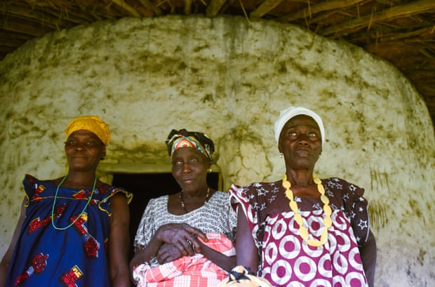 Three of the 12 priestesses of Orango Island, after a traditional ceremony to determine whether it is time to harvest the palm fruit.