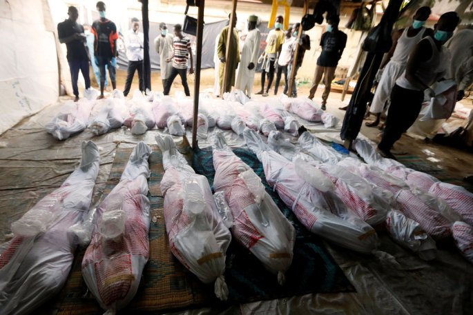 Members of the Islamic Movement of Nigeria preparing the bodies of members killed when the Nigerian Army opened fire during the group's protests in the capital Abuja this week. Photo: Afolabi Sotunde/Reuters