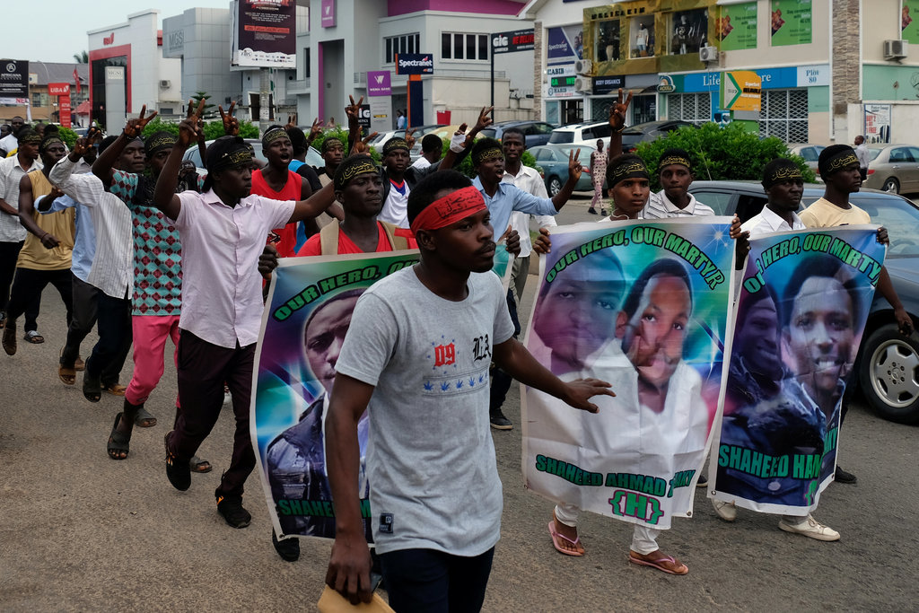 Members of the Islamic Movement of Nigeria marching to demand the release of their leader, Ibrahim Zakzaky, in Abuja on Wednesday. Photo: Paul Carsten/Reuters