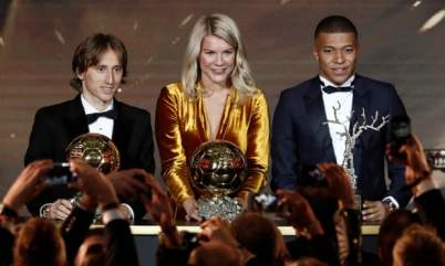 Luka Modric, Ada Hegerberg and Kylian Mbappé pose with their awards. Photograph: Benoît Tessier/Reuters