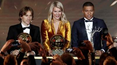 Luka Modric, Ada Hegerberg and Kylian Mbappé pose with their awards. Photograph: Benoît Tessier/Reuters
