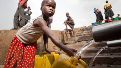 Filling water cans in a slum in Kampala, where lack of toilets and clean water is exacerbating the spread of cholera in some areas.