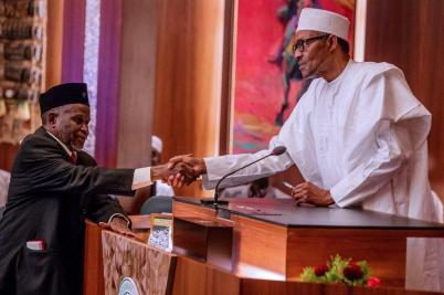 President Buhari exchanging handshake with Ibrahim Tanko Mohammed after the Later's inauguration as Chief Justice of Nigeria