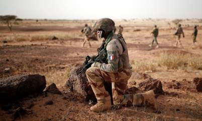 Malian and French soldiers on patrol in Mali, where France has been aiding counter-insurgency efforts.