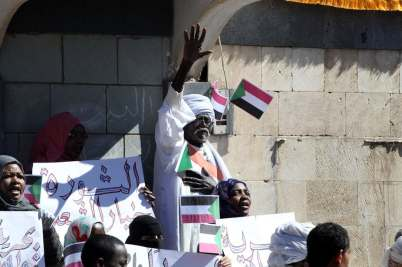 Sudanese protesters shout slogans during a rally against the government of President Omar al-Bashir in Sana'a.