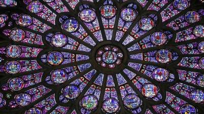 Cosmic wheels of colour … the cathedral's rose windows. Photograph: Patrick Kovarik/AFP/Getty Images