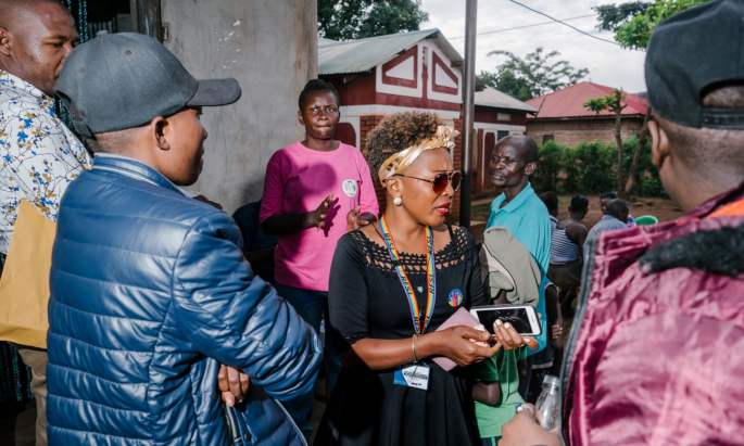 Maria Nantale, centre, at an outreach event hosted by the Aids Support Organisation, a health services group, and Uganda's Eastern Region Women's Empowerment Organisation. Photograph: Jake Naughton