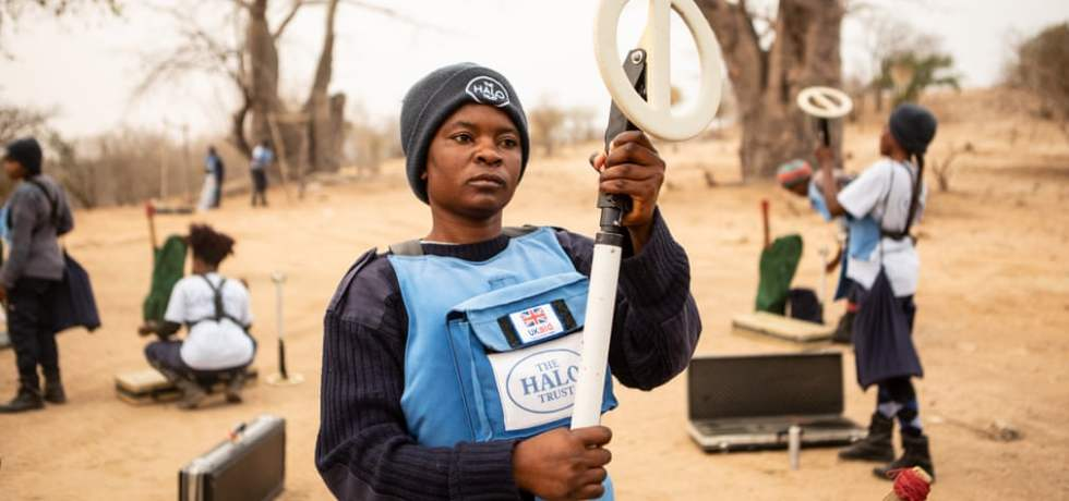 Loriana Tchulo Tavares Sacanombo prepares her equipment for mine clearing.
