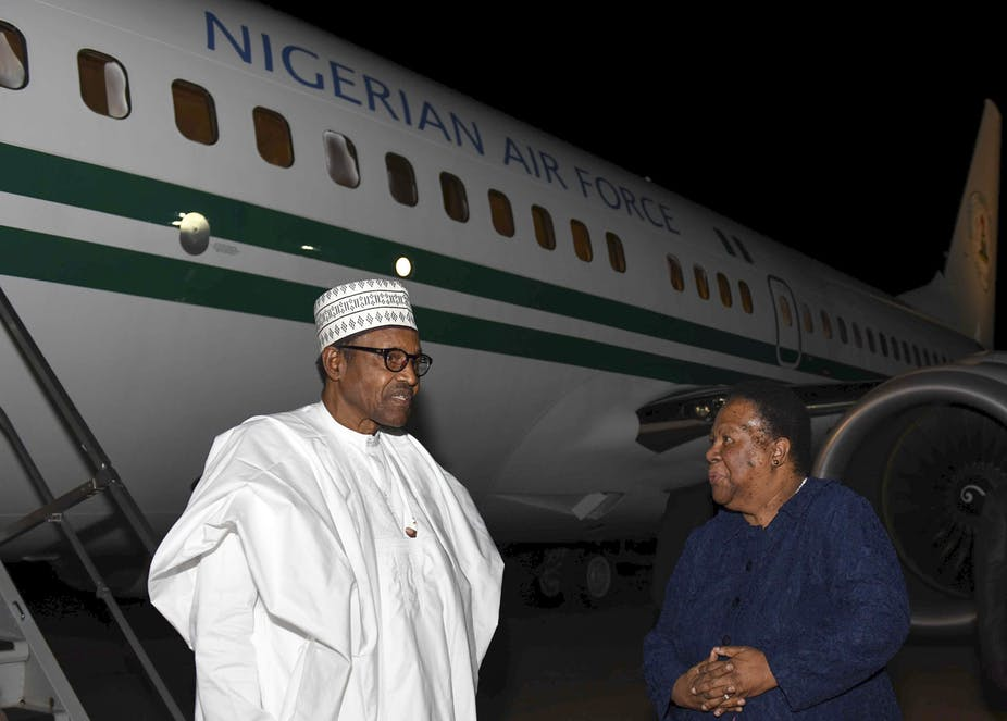 President Muhammadu Buhari of Nigeria (left) arriving at Waterkloof Airforce Base Airport in Pretoria. He is welcomed by Minister Naledi Pandor. Katlholo Maifadi/EPA/DIRCO