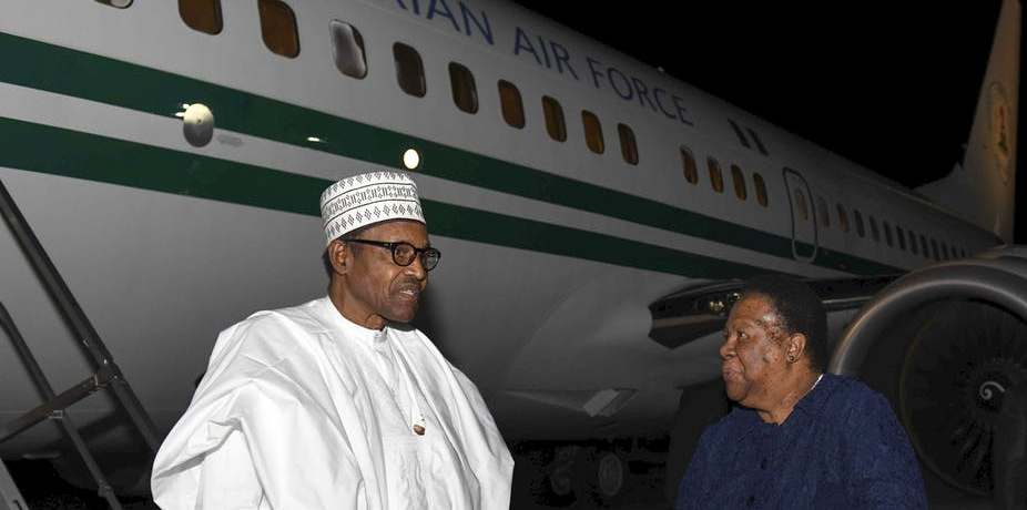 President Muhammadu Buhari of Nigeria (left) arriving at Waterkloof Airforce Base Airport in Pretoria. He is welcomed by Minister Naledi Pandor. Katlholo Maifadi/EPA/DIRCO