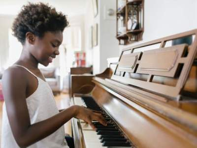 Playing an instrument can improve a child's memory, coordination and teach them perseverance. Photograph: Raymond Forbes LLC/Stocksy United