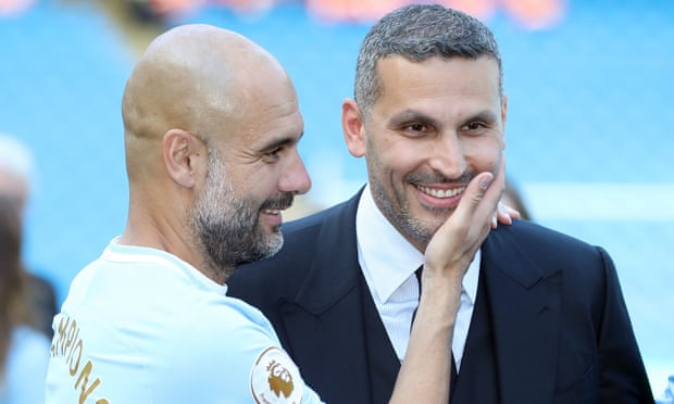 Pep Guardiola with Khaldoon al-Mubarak, who sees FFP as a restraint of Sheikh Mansour's freedom to rebuild City by pouring money in. Photograph: Martin Rickett/PA