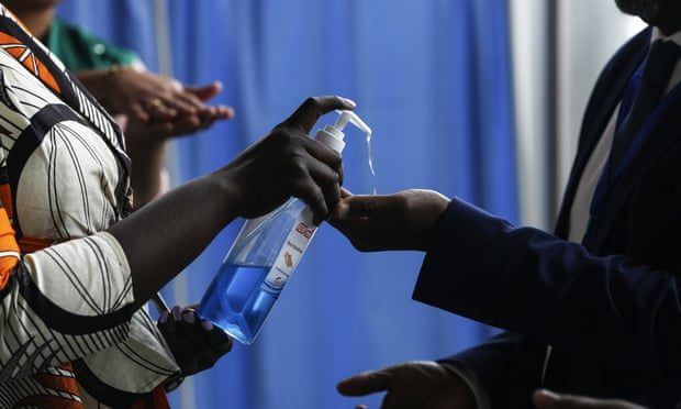 People at the African Union headquarters in Addis Ababa are given disinfectant. Ethiopia is one of several African countries where coronavirus tests have so far proved negative. Photograph: Anadolu Agency via Getty Images