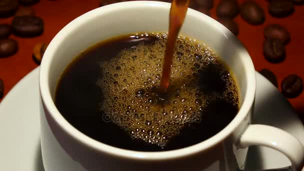Pour black coffee in white cup