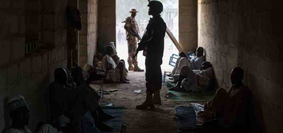 Nigerian soldiers guarding civilians who had fled the fighting in Bama in 2015. The country's military had retaken the northeastern town from Boko Haram, but about 7,500 people were displaced by the fighting. Photograph: Nichole Sobecki/AFP