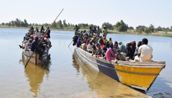 Refugees packed into motorized canoes arrive in Ngouboua, Chad after fleeing previous violence in the Lake Chad and Sahel area. Credit: UNHCR/Aristophane Ngargoune