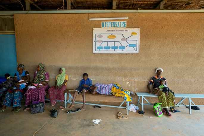 Women and children wait to be treated at a health clinic in northern Burkina Faso. Giles Clarke/UNOCHA via Getty Images