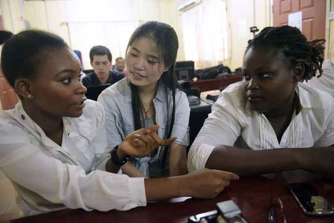 A Chinese language teacher speaks with students at the Confucius Institute at the University of Lagos. PIUS UTOMI EKPEI/AFP via Getty Images
