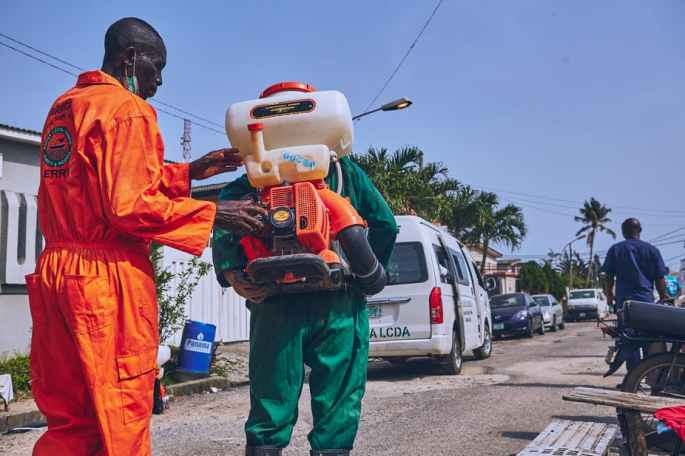 Lagos state officials disinfecting roads in the state. Shutterstock