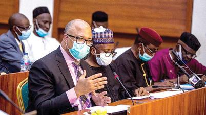 Director General, Nigeria Centre for Disease Control (NCDC), Dr. Chikwe Ihekweazu (left) explaining details of spending of funds for COVID-19 response to the Public Accounts Committee of the House of Representatives in Abuja.