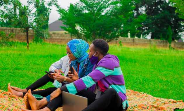 Young people relaxing in a garden. shutterstock